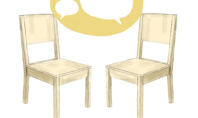 two yellow wooden chairs talking to each other