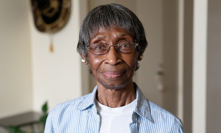older woman with glasses and gentle smile