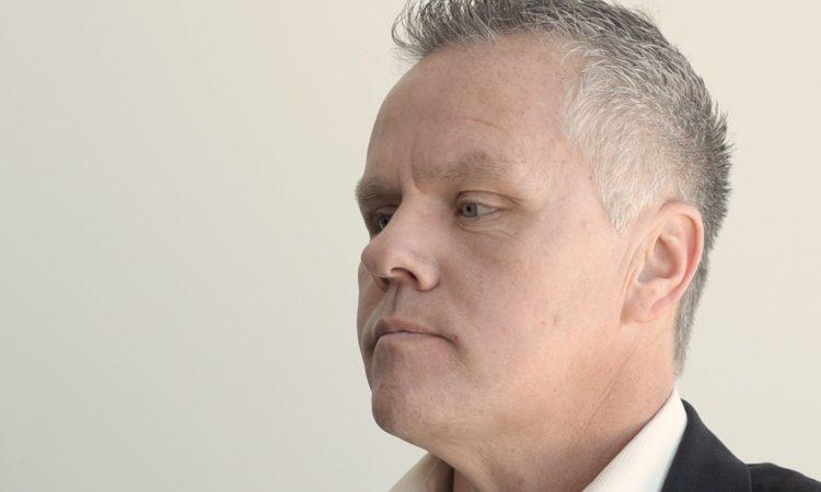 man with short, graying hair