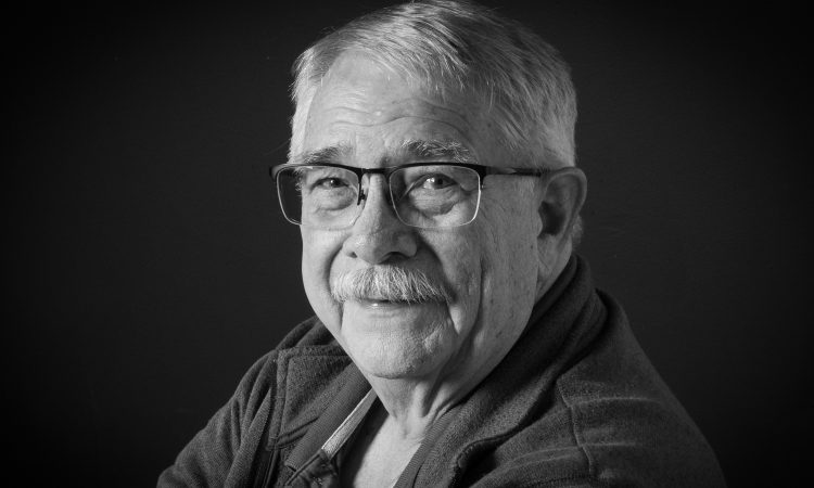 older man with glasses and mustache
