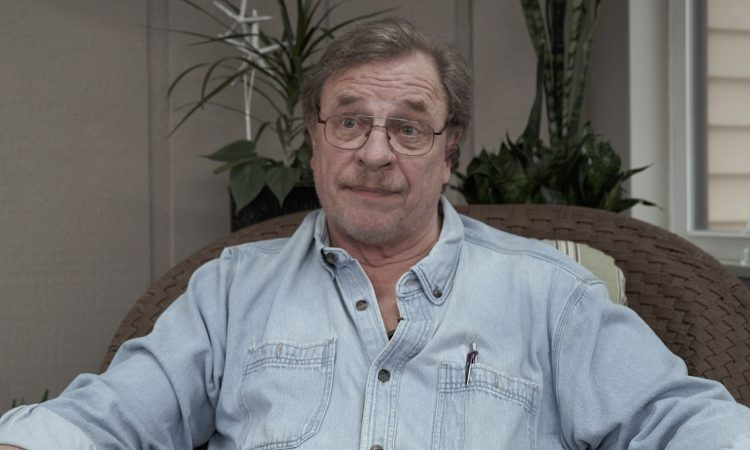 man with glasses in blue jean work shirt
